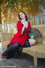 Lady on the Bench (Laveen Photography (aka cyclist451)) Tags: red arizona black bench fan dress az goodyear estrellaranch