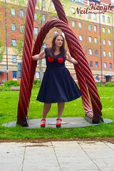 IMG_4470 (Neil Canon Keogh) Tags: red black vintage necklace highheels dress retro ring redhead bow buskers bracelet heels rockband pinup pinupgirl trianglesquare manchestercitycenter dressmodellaura