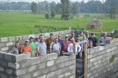 Nepal re-building (laurazimmerman81) Tags: nepal earthquake building home team carry brick stone basket work people