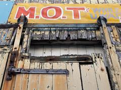 back street garage 03 jul 16 (Shaun the grime lover) Tags: cheshire back street garage wooden door peeling paint mot sign warrington building doorway industrial rusty texture bankquay liverpoolroad