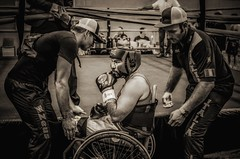 Adaptive Boxer from Team Italia lifted into the ring for his fight (sophie_merlo) Tags: wheelchair wheelchairsport wheelchairsports adaptivesport adaptiveboxing wheelchairboxing boxing sport sports bw mono monochrome noir documentary photojournalism disablity disabled disabledathlete paralympic chance fight warriors fighters disabledfighters blackandwhite amputee amputees courage