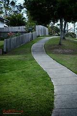 Another Curvy Footpath in Carina (Kent Johnson) Tags: 1000logoadjsef5643 footpath carina brisbane lungastreet curvy bent green grass pavement queensland suburbs suburbia fujifilmxt1 xf35mmf14r