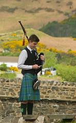 Piper Calling at Eilean Donan (margaretc1946) Tags: piper bagpipes eileandonancastle pentax