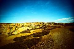 Parys Mountain Copper Mine (hala moodie) Tags: anglesey wales cymru parysmountain coppermine copper mine parys expiredfilm kodakektachrome100 slidefilm e6 xpro xprocess crossprocess crossprocessed lomo lomography lomolcw lomolcwide lcw lcwide film analogue