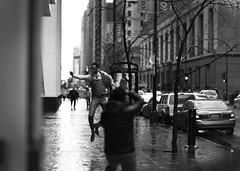 Chicago downtown Spring 2016 Flying guy (Stefano-Bosso) Tags: stefanobosso love chicago illinois streetsjooting spring rain flying advertising monochrome noiretblanc blackwhite blackwhitephotos canon people streetshooting mono biancoenero monocromo