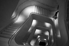 (cherco) Tags: alone solitario lonely light luz down bajar stairs escaleras perspectiva perspective solitary silhouette silueta shadow sombra blackandwhite blancoynegro composition composicion canon human man canoneos5diii vertigo arquitectura modern