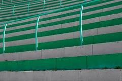 green stands (loop_oh) Tags: bergiselsprungschanzestadion fis fisskijumpingworldcup fourhillstournament sprungschanze worldcup zahahadid alps austria bergiselschanze hill inn innsbruck oesterreich schanze skijumping skijumpinghill stadion tirol sterreich stand stands audience observer viewer spectator bystander onlooker viewership terraces section seats rail rails stair stairs