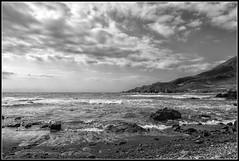 Paseando por El Cabo de Gata (Fernando Fornis Gracia) Tags: espaa andaluca almera cabodegata parquenaturaldelcabodegata mar olas nubes rocas blancoynegro wb paisaje landscape naturaleza