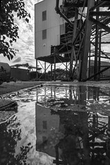 Mood for reflection, Charlton (Sean Hartwell Photography) Tags: southbank thames thamesestuary riverthames london charlton woolwich greenwich industry industrial decay puddle reflection monochrome blackandwhite lowpointofview canoneosm3 1122mm factory cement works