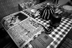 1940's Kitchen. (aquanout) Tags: blackandwhite monochrome pipe newspaper table chair