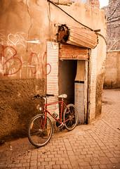 The Red Bike (Culinary Fool) Tags: africa door november red brick bike stone wall cobblestone morocco marrakech marrakesh curve 2012 culinaryfool visit2 2470mm28 brendajpederson