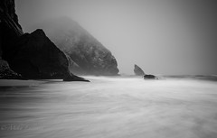 Misty seascape (Mika Laitinen) Tags: atlanticocean canon7dmarkii europe leebigstopper leefilters leendgrad portugal praiadaadraga sintra tokina1116mm beach cliff cloud fog landscape longexposure mist nature ocean outdoor rock sea seascape shore sky summer water wideangle colares lisboa pt bw