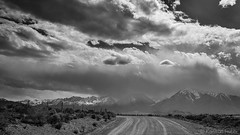The Road To Rain - 6967_B&W (www.karltonhuberphotography.com) Tags: 2016 adventure bw blackandwhite brush california change clouds countryroad dirt dirtroad distantrain easternsierra exploring fenceline horizontalimage karltonhuber landscape landscapephotography mountainpeaks nature outdoors owensvalley rain ranchland sky snowcappedpeaks tension tiretracks weather