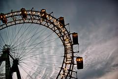 Round and Round (MarkE_T) Tags: austria buildingsandstructures vienna giantferriswheel wienerriesenrad wheel clouds prater silhouette ferriswheel pentaxk10d smcpentaxda1855mmf3556al