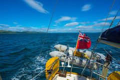 Farewell Scotland.... (Dafydd Penguin) Tags: sailing sail sailboat boat boating cruising yacht yachting cruise scotland west coast sound jura inner hebredes flag ensign sea water clouds sun nikon d600 nikkor 20mm af f28d