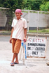 parking attendant (DOLCEVITALUX) Tags: parkingattendant parking attendant man outdoor portrait philippines