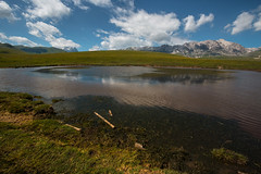 July snow reflects into Racollo Lake (luigig75) Tags: campo imperatore abruzzo italia italy 70d gran sasso parconazionaledelgransassoemontidellalaga landsca landscape mountains canonefs1022mmf3545usm