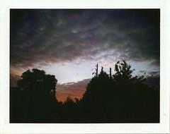 Red Sky Over Crumpsall (iGladsPhotoWorld) Tags: polaroid mamiya mamiyapressuniversal film fujifilm fp100c fujicolour instant manchester mediumformat colour sky red crumpsall clouds