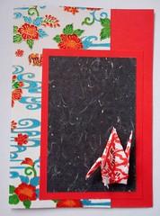 APC99 (tengds) Tags: card allpurposecard handmadecard japanesepaper bingata okinawabingata origamipaper chiyogami red papercrane crane black flowers white blue swirls papercraft tengds