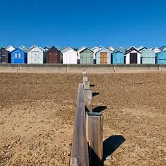 On the beach (Hilary Causer) Tags: beach sand felixstowe suffolk bluesky beachhuts groyne divide squareformat september sunny coastal seaside england
