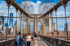 2016 - New York City - Brooklyn Bridge - Manhattan Tower - 5 of 5 (Ted's photos - For Me & You) Tags: 2016 cropped nikon nikond750 nikonfx nyc newyorkcity tedmcgrath tedsphotos vignetting backpack cables wirs manhattan brooklynbridge bridge arches people peopleandpaths photographer camera ballcap usaflag flag sunglasses walking walkway walkers highrise tower towers rivots
