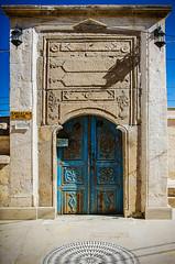 To the eagle's cave (Melissa Maples) Tags: ortahisar turkey trkiye asia  nikon d5100   nikkor afs 18200mm f3556g 18200mmf3556g vr kapadokya cappadocia text sign archway blue door eaglecavehotel trkiye