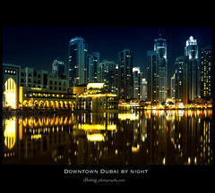 Downtown Dubai by night (dhmig) Tags: travel reflection water night skyscraper buildings lights downtown dubai nightscape skyscrapers nightshot unitedarabemirates famousplace famoustraveldestination