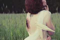 Preview of Fallen (catchildsarah) Tags: pink white field grass sarah forest hair photography washington wings hands arm bokeh lace magic feathers redhead angels corset wound tulle supernatural caity angelwings zombiemakeup trickler sfxmakeup dovewings sarahtrickler