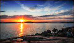 airisto sunset (Joni Aarnio) Tags: sunset sea summer sun colour water birds clouds suomi finland landscape evening nikon rocks 1020mm joni d90 airisto aarnio