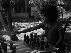 Young filipina plays chess (Scossadream) Tags: 201605 palawan manila philippines filippine tuktukbike intramuros spacemonkeypictures spacemonkey smp scossa lucaguizzardi nikond7100 d7100 sanaugustinmuseum cathedralofmanila youngfilipinaplayschess tunnel island islands floweredbalcony hondabay starfishes pufferfish beach sea wonderfulsea seacreek stripoflanddividedthesea signallingflags puertoprincesa sabang subterraneanriver puertoprincesasubterraneanriver monkey catamaran trip bestbasketballcourtlocationever basket monsters