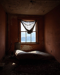 SMDSC_0223 (thetiffers) Tags: abandoned left behind explored abandon desolate america vacant lost place old rotten decay ruin urban ruin derelict ue explorer nikon forgotten exploration neglected death united states empty waste decay usa hotel bed window sleazy curtain mattress grime beautifullight creepy scary