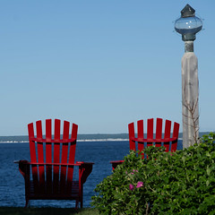 Watching the Water (Bud in Wells, Maine) Tags: kennebunkport maine atlantic coast chairs coastal newengland red pse stonehouse