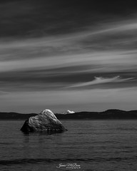 Geologic/ Atmospheric - Mt. Doug Beach with Mt. Baker in the Distance (James McBean Photography) Tags: vancouverisland landscape seashore nature water mountains outdoor sea mtbaker cloudporn ocean monochrome rock britishcolumbia mtdougbeach cloudscape blackandwhite seascape clouds victoriabc seaside