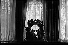 (frscspd) Tags: 62540019 20160619 pentax pentaxmx mx takumar takumar58mm 58mm ilford ilfordxp2 ilfordxp2400bw film filmgrain oxburghhall oxborough window windowsill curtain shadow shadows windows silhouette nativity baroque ornament presepe porcelain