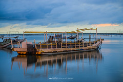 (Yen ZOO) Tags: sea beach ebb fishing boat oyster    sunset inverted image