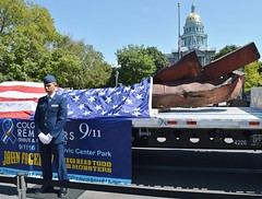 Member of US Air Force  standing in front of 9/11 wreckage displayed on flatbed truck, American flag draped over wreckage, Colorado capitol building in the background. (desrowVISUALS.com) Tags: march military 911 americanflag capitoldome coloradostatecapitol capitol terrorism 91115thanniversary nineelevenanniversary nineeleven worldtradecenter twintowers terroristattack 911wreckage 911anniversary 911rememberance militaryparade militarymarch soldiersmarching militarymarching capitolbuilding worldtradecenterattack