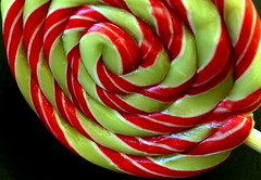mint lollipop (overthemoon) Tags: home lollipop pandorabell mint whorl spiral green red white macromondays av f8 experiment sweetspotsquared sweetspot candy closeup stripes utata:project=seeingred