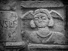 Etruscan tombstone (JoshyWindsor) Tags: ancient sculpture wings tuscany montepulciano bricks travel antique tombstone relief italy etruscan canoneos6d europe holiday blackwhite