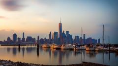 NJ to NYC II (iShootPics) Tags: newyorkskyline sunrise sel1635z water reflections boats flickr shore sun dock bright sonya7r pretty river morning cityscape light