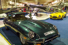 A 1970 Jaguar E-Type Series 2 2+2 Coup, a 1988 AC Cobra Mark IV Roadster and a WWII Spifire at the RAF Museum, Hendon (Anguskirk) Tags: uk england london airplanes historic spitfire militaria rafmuseumhendon bonhams royalairforce militaty 1970jaguaretypeseries222coup 1988accobramarkivroadster