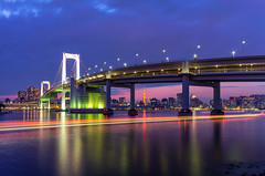 Waterfront Cruising, Tokyo (45tmr) Tags: city longexposure nightphotography japan night landscape tokyo cityscape nightscape nightshot pentax explore 東京 lighttrails nightview daiba 夜景 tokyobay rainbowbridge k5 台場 レインボーブリッジ explored 光跡 薄暮 pentaxk5
