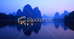 Fisherman on li river (MPBHAIBO) Tags: china morning blue mountain reflection night sunrise river landscape dawn liriver fishing fisherman dusk guilin yangshuo hill bamboo cormorant    traditionalculture  chineseculture    mountainpeak fishingindustry asianculture  karstformation nauticalvessel chineseethnicity woodenraft guangxiregion