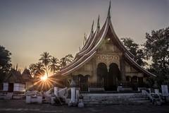 Wat Xieng Thong - Luang Prabang - Laos (jonasginter) Tags: travel sunset evening asien quiet peace buddha calm laos sonne gebude luangprabang reise tempel weltkulturerbe heilig treppen watxiengthong gott palmen mekog