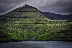 The Backdrop To Funningur (Baron Reznik) Tags: adventure colorimage eastisland europa europe exploration explore eysturoy faroeislands funding funningur frerne froyar hdr horizontal island landscape mountain mtn nature picturesque roadtrip scenic scenicview slttaratindur sonyfe24240mmf3563oss village ster