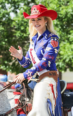 Miss Rodeo America 2016 (wyojones) Tags: wyoming cody codystampede rodeocapitaloftheworld codystampedeparade 4thofjuly cowgirl equestrian cowgirlhat horse redwhiteandblue hat crown beautiful pretty cute blonde girl woman horsewoman saddle smile wave chaps earrings