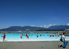 Hot day at Kits Pool (Ruth and Dave) Tags: kitsilano kits pool swimmingpool outdoorpool swimming swimmers lifeguard englishbay mountains view paddling wading summer weather weatherphotography
