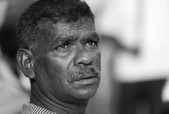 Man at Buddhist festival in Galle (JoshyWindsor) Tags: galle streetphotography face portrait expressive people canonef70300mmf456l blackwhite srilanka canoneos6d moustache southcoast holiday