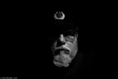 (Neil. Moralee) Tags: man face portrait selfie selfy self mature old russian hat beard glasses white black bw blackandwhite mono monochrome shadow badge cap hammer cycle sikle ussr russia fur neil moralee nikon d7100 18300mm zoom blackbackground dark sinister enemy comrad vladinir revolution revolutionary ushanka ears capcold winter cold comrade