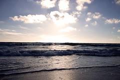 I see sea (lligaa) Tags: latvia ventspils sea beach water baltic sunset sand wet waves wind sun clouds blue light view landscape beautiful nature europe