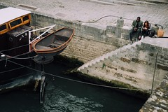 Port Side (Rebecca Haranczak) Tags: boat canal river water rowboat couple stairs stone pov paris september vsco sony sonya7r 70mm gmaster france color